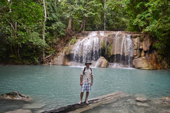 Young man at Erawan falls in Thailand Royalty Free Stock Photography