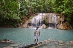 Young man at Erawan falls in Thailand Royalty Free Stock Photography