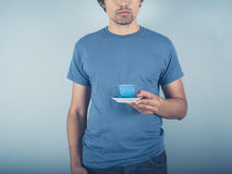Young man with espresso Stock Photos