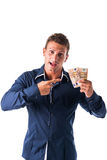Young man with euro bills or banknotes in his Royalty Free Stock Image