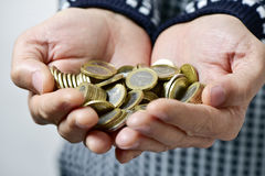 Young man with euro coins in his hands Royalty Free Stock Photography