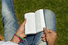 Young Man Ex-muslim Reading Bible Outside Royalty Free Stock Photography