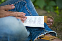 Young Man Ex-muslim Reading Bible Outside Stock Photo