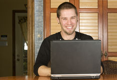 Young man excited on computer Royalty Free Stock Image