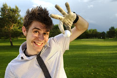 Young man excited about golf. Ready to play on golf course Stock Photography
