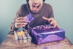 Young man excited about his presents Royalty Free Stock Photos