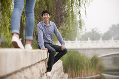 Young Man Excited to See His Girlfriend by the Canal Royalty Free Stock Images