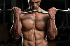 Young Man Exercise With Barbell Royalty Free Stock Image