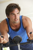 Young Man On Exercise Bike Royalty Free Stock Photo