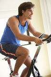 Young Man On Exercise Bike Royalty Free Stock Photography