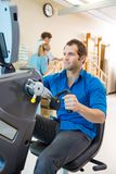 Young Man On Exercise Bike In Hospital Stock Photos