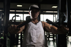 Young Man Exercise Chest On Machine Royalty Free Stock Images