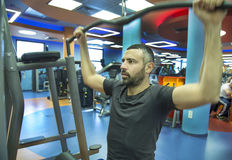 Young Man Exercise At The Gym Royalty Free Stock Images