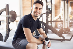 Young man exercise in the gym healthy lifestyle. Young male exercise in the gym drinking water Stock Images
