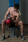 Young Man Exercise With Kettle Bell Biceps Stock Photography