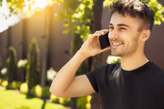 Young man exercise in the park healthy lifestyle. Young male exercise in the park phone call Stock Images