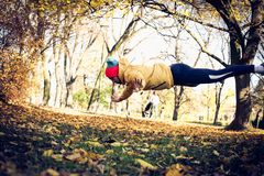 Young man exercise in park. Pushups jump. Stock Image