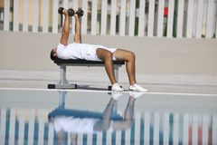 Young man exercise at poolside Royalty Free Stock Photo