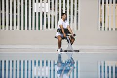Young man exercise at poolside Stock Photo