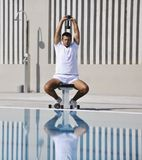 Young man exercise at poolside Royalty Free Stock Photos