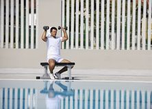 Young man exercise at poolside Stock Image