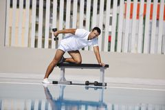 Young man exercise at poolside Stock Photography