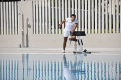 Young man exercise at poolside Stock Photos