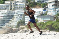 Young man exercise running on the beach Stock Photo