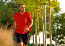 Young man exercise running outdoors Stock Photography