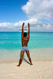 Young man exercises on Caribbean island during his royalty free stock photography