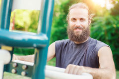 Young man exercises gym outdoors Stock Image