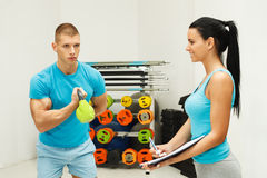 Young man exercises with kettle bell Royalty Free Stock Photo