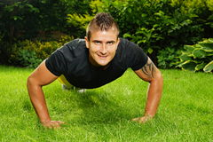 Young man exercises push up Royalty Free Stock Photos
