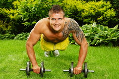Young man exercises push up Royalty Free Stock Image