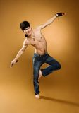 Young man exercising. Standing on one foot Royalty Free Stock Images
