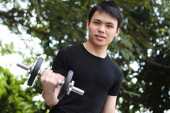Young man exercising Stock Photo