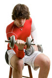 Young Man Exercising. A young man lifting weights over a white background royalty free stock image