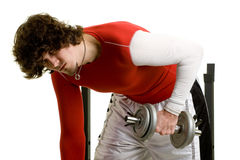 Young Man Exercising. A young man lifting weights over a white background stock photography