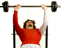 Young Man Exercising. A young man lifting weights over a white background royalty free stock photo