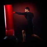 Young man exercising bag boxing Stock Photos