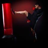 Young man exercising bag boxing Stock Image