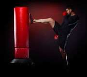 Young man exercising bag boxing Stock Photos
