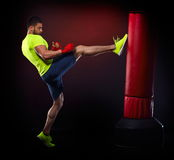 Young man exercising bag boxing Royalty Free Stock Photography