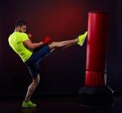 Young man exercising bag boxing in studio Royalty Free Stock Photos