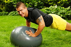 Young man exercising with ball Stock Photo