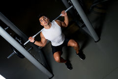 Young man exercising with barbell Squats Royalty Free Stock Photos