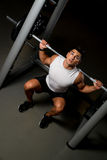 Young man exercising with barbell Squats Stock Photos