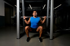 Young man exercising with barbell Squats Royalty Free Stock Image