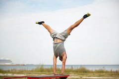 Young man exercising on bench outdoors Royalty Free Stock Image