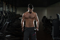 Young Man Exercising Biceps With Dumbbells Stock Photos